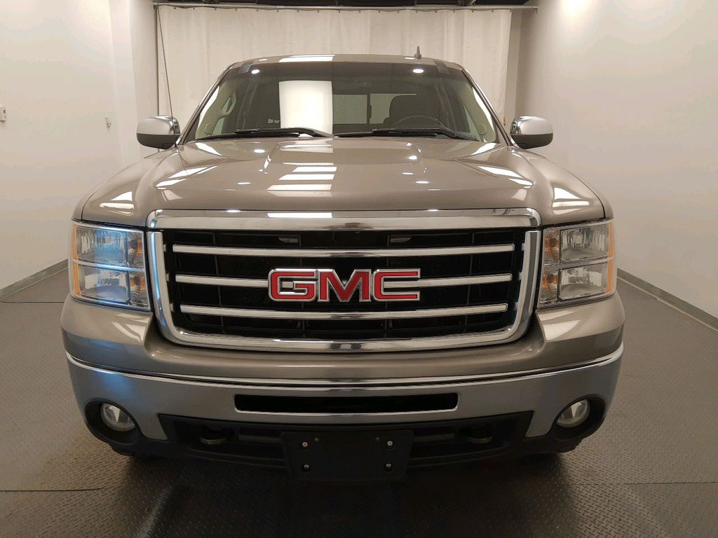 Grey 2013 GMC Sierra 1500 Left Front Rim and Tire Photo in Lethbridge AB