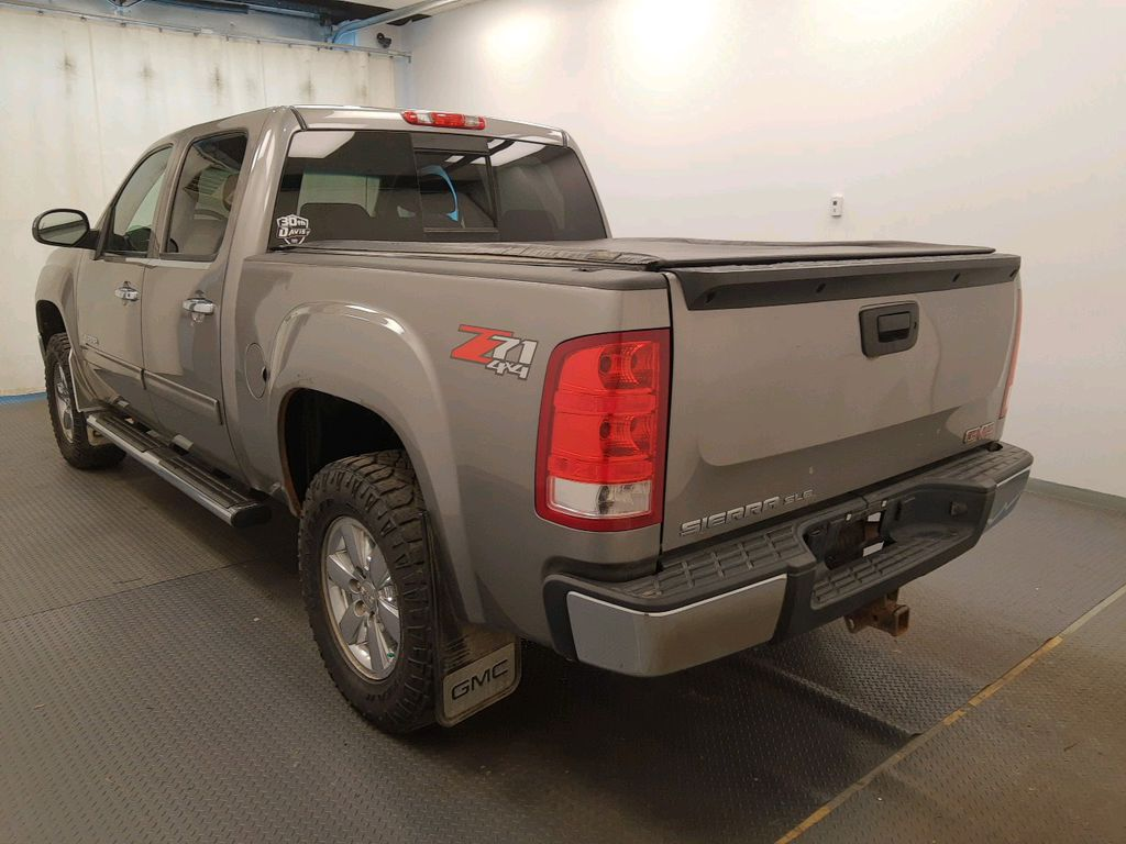 Grey 2013 GMC Sierra 1500 Left Front Head Light / Bumper and Grill in Lethbridge AB