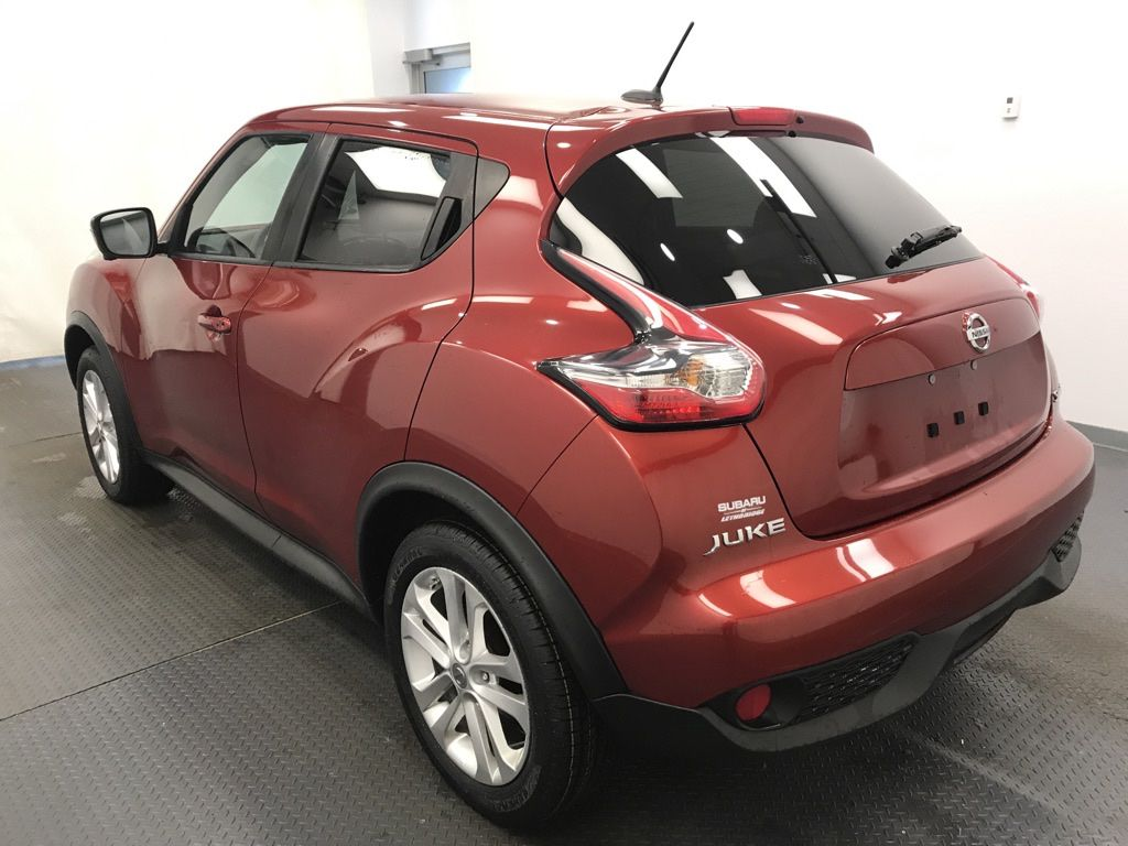 Red 2017 Nissan JUKE Left Front Rim and Tire Photo in Lethbridge AB