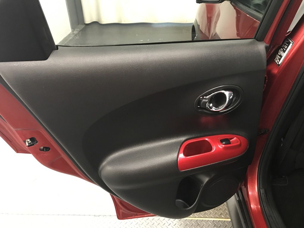 Red 2017 Nissan JUKE Central Dash Options Photo in Lethbridge AB