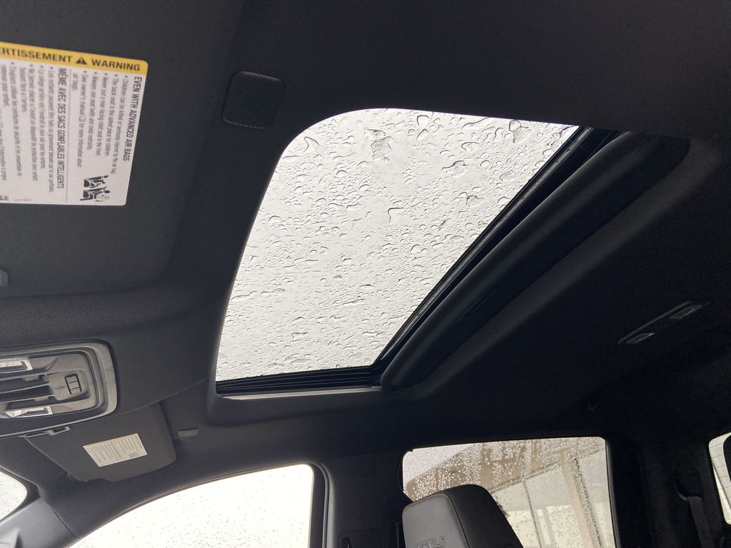 White[Summit White] 2021 GMC Sierra 1500 AT4 Sunroof Photo in Calgary AB