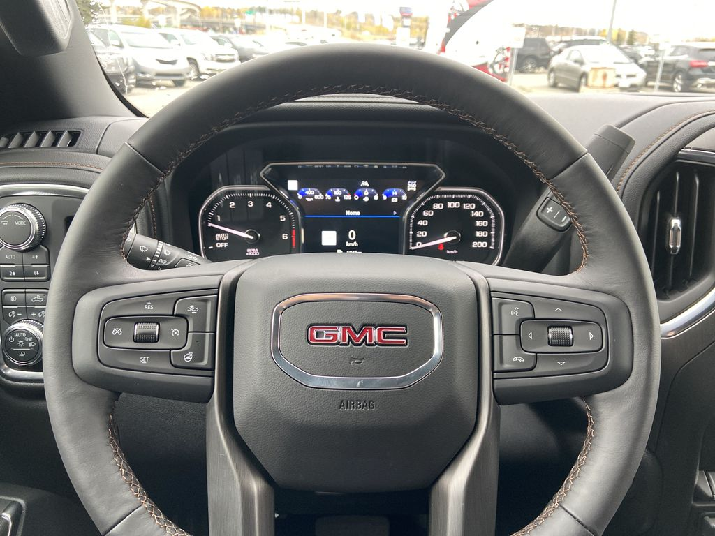 White[Summit White] 2021 GMC Sierra 1500 AT4 Steering Wheel and Dash Photo in Calgary AB