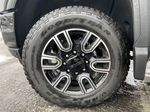 Black[Carbon Black Metallic] 2020 GMC Sierra 3500HD AT4 Left Front Rim and Tire Photo in Calgary AB