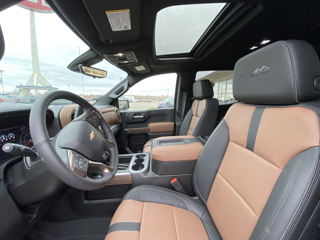 White[Iridescent Pearl Tricoat] 2021 Chevrolet Silverado 1500 High Country Left Front Interior Photo in Calgary AB