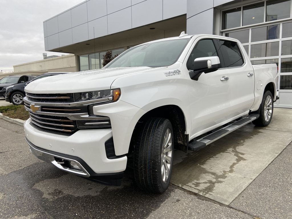 White[Iridescent Pearl Tricoat] 2021 Chevrolet Silverado 1500 High Country Left Front Head Light / Bumper and Grill in Calgary AB