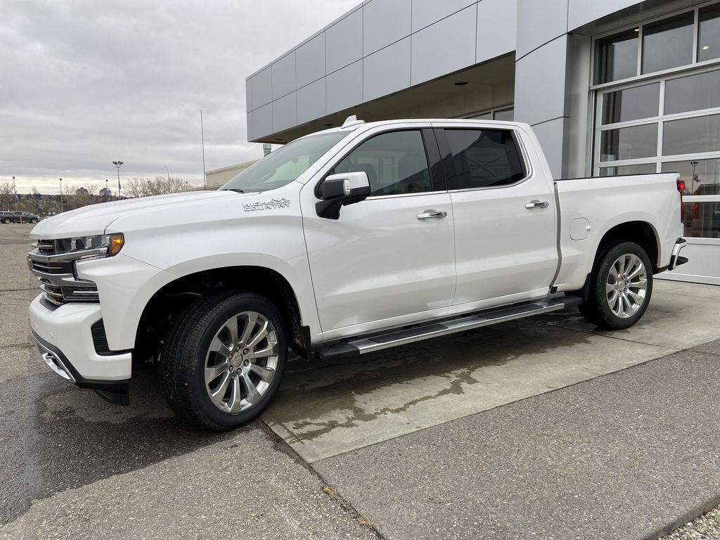 White[Iridescent Pearl Tricoat] 2021 Chevrolet Silverado 1500 High Country Left Front Corner Photo in Calgary AB