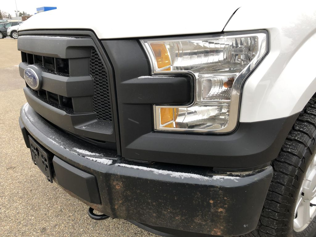 White[Oxford White] 2015 Ford F-150 Left Front Head Light / Bumper and Grill in Edmonton AB