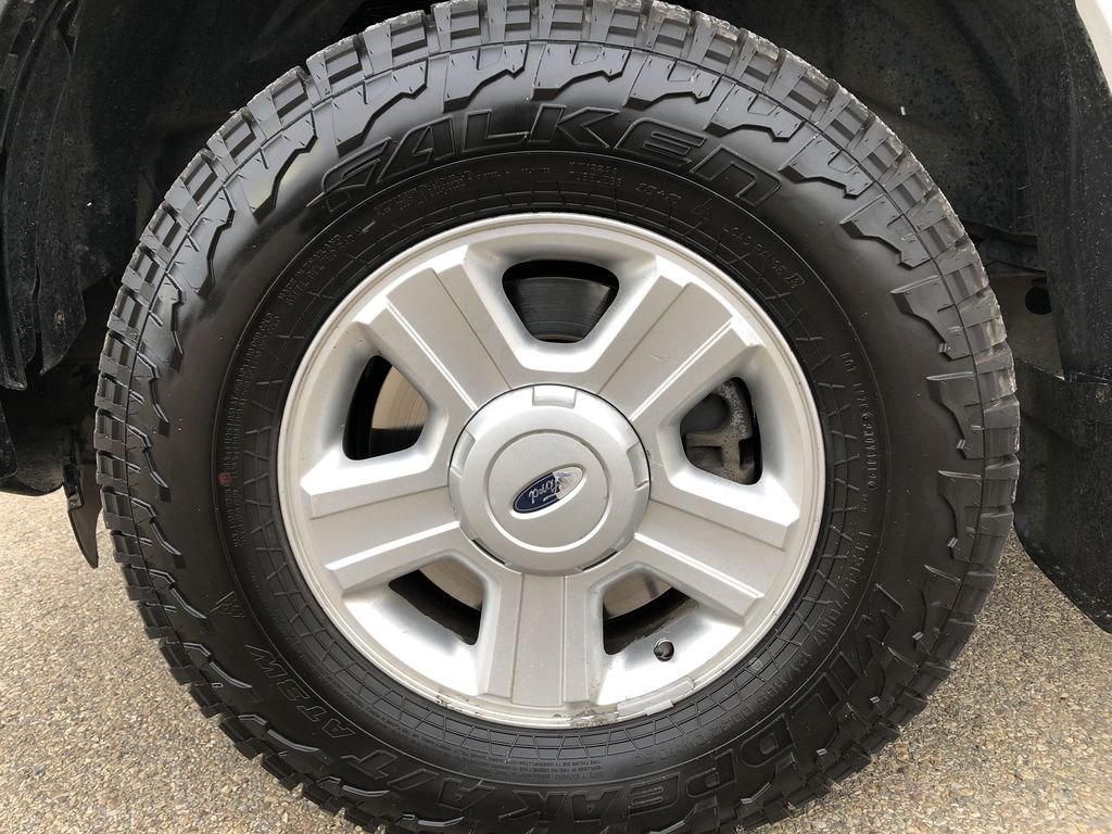 White[Oxford White] 2015 Ford F-150 Left Front Rim and Tire Photo in Edmonton AB