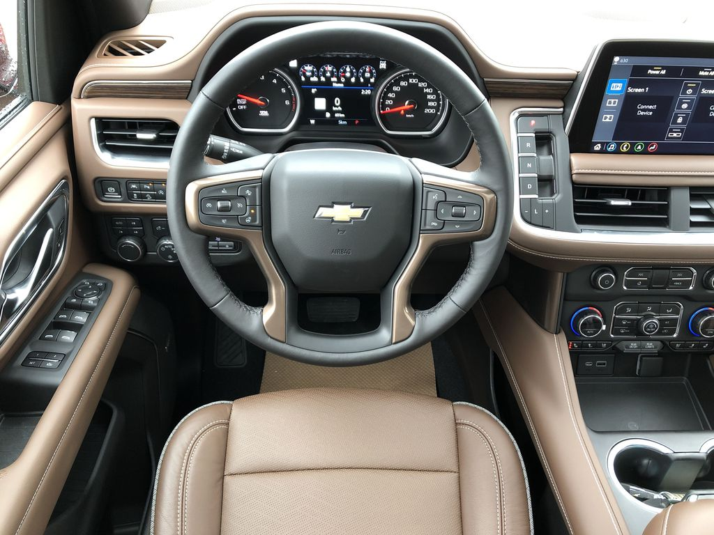 Red[Cherry Red Tintcoat] 2021 Chevrolet Tahoe Strng Wheel/Dash Photo: Frm Rear in Edmonton AB