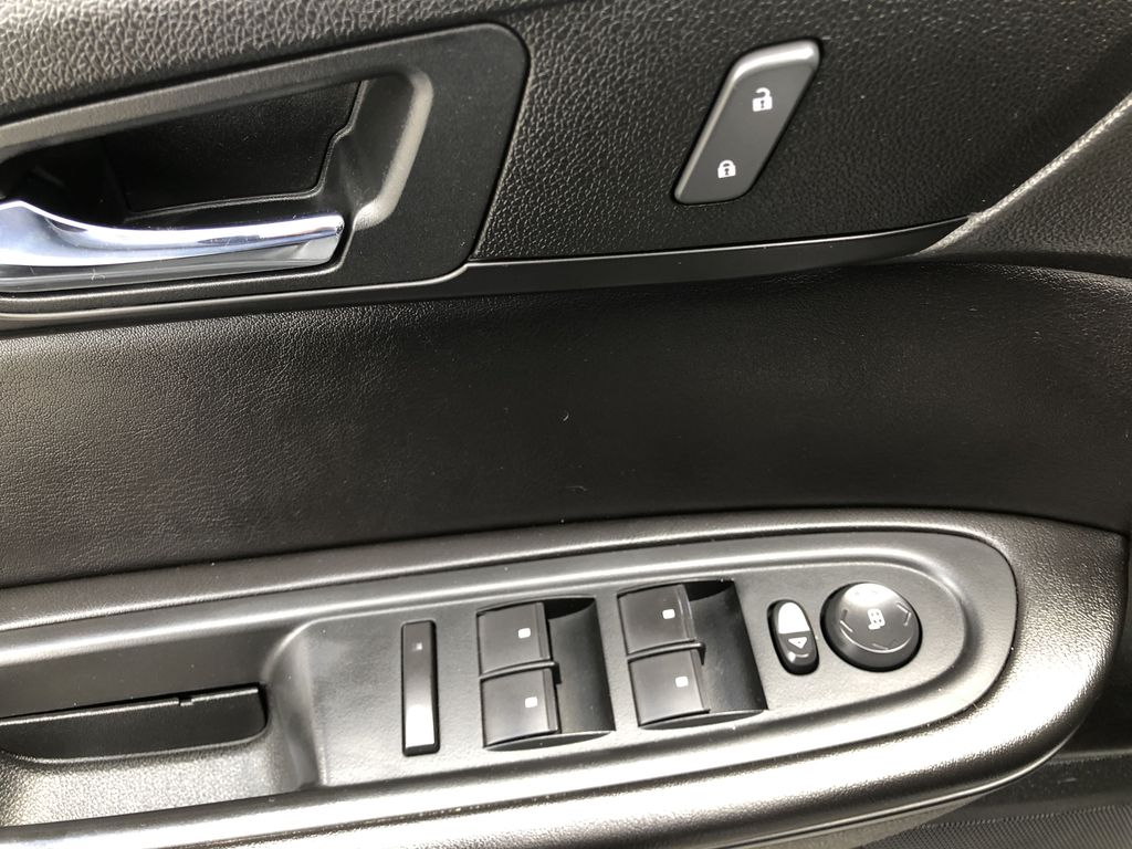 Silver[Quicksilver Metallic] 2015 GMC Acadia SLE  Driver's Side Door Controls Photo in Canmore AB