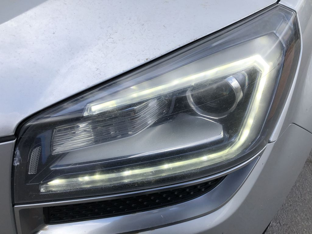 Silver[Quicksilver Metallic] 2015 GMC Acadia SLE Left Front Head Light / Bumper and Grill in Canmore AB