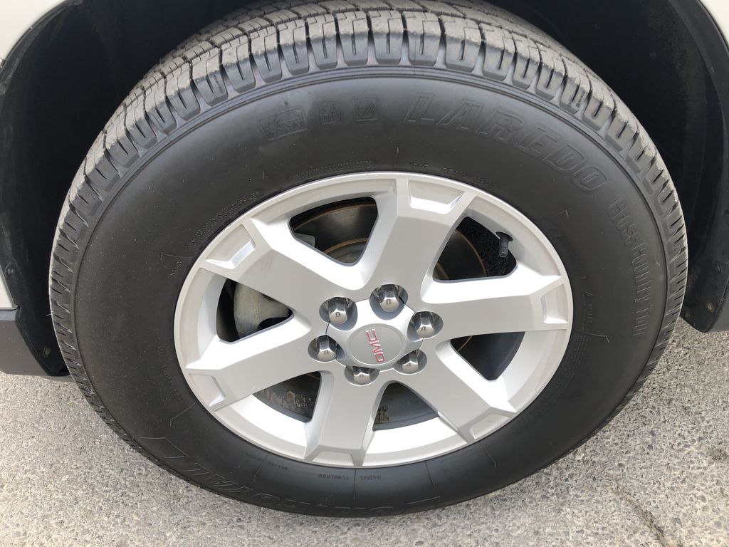 Silver[Quicksilver Metallic] 2015 GMC Acadia SLE Left Front Rim and Tire Photo in Canmore AB