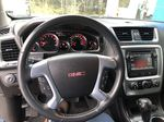 Silver[Quicksilver Metallic] 2015 GMC Acadia SLE Steering Wheel and Dash Photo in Canmore AB