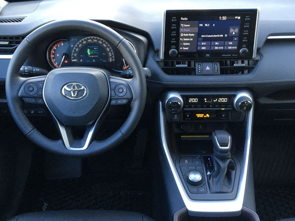 03T3 Ruby Flare Pearl 2021 Toyota RAV4 Limited AWD Steering Wheel and Dash Photo in Kelowna BC