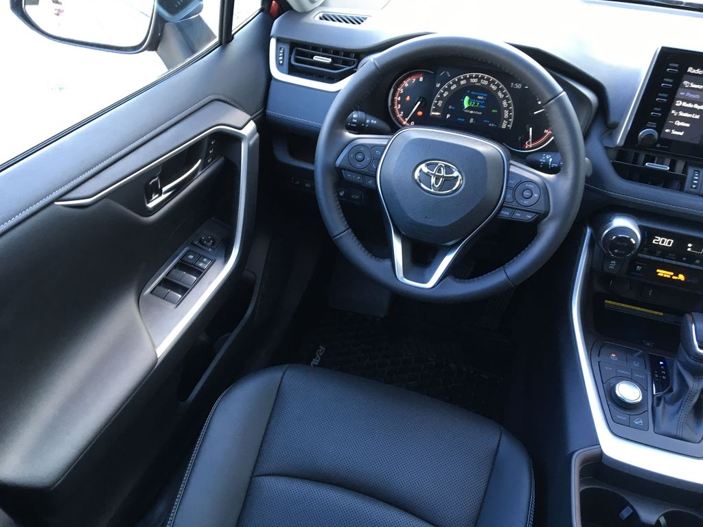 03T3 Ruby Flare Pearl 2021 Toyota RAV4 Limited AWD Left Front Interior Door Panel Photo in Kelowna BC