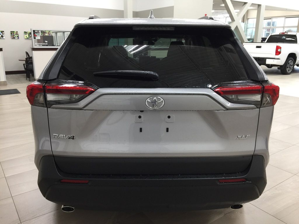 Silver[Silver Sky Metallic] 2021 Toyota RAV4 XLE FWD Rear of Vehicle Photo in Sherwood Park AB