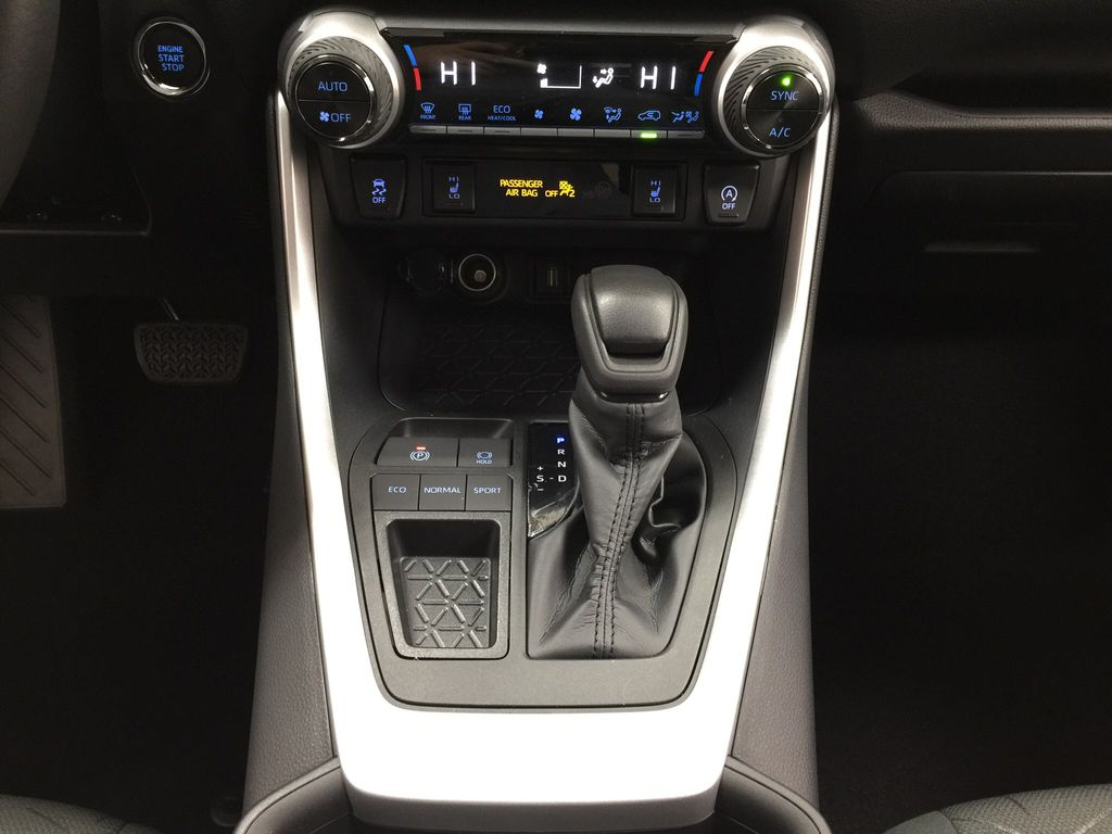 Silver[Silver Sky Metallic] 2021 Toyota RAV4 XLE FWD Lower Dash Photo in Sherwood Park AB
