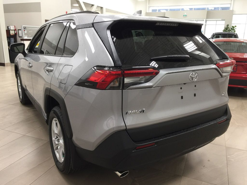 Silver[Silver Sky Metallic] 2021 Toyota RAV4 XLE FWD Left Rear Corner Photo in Sherwood Park AB