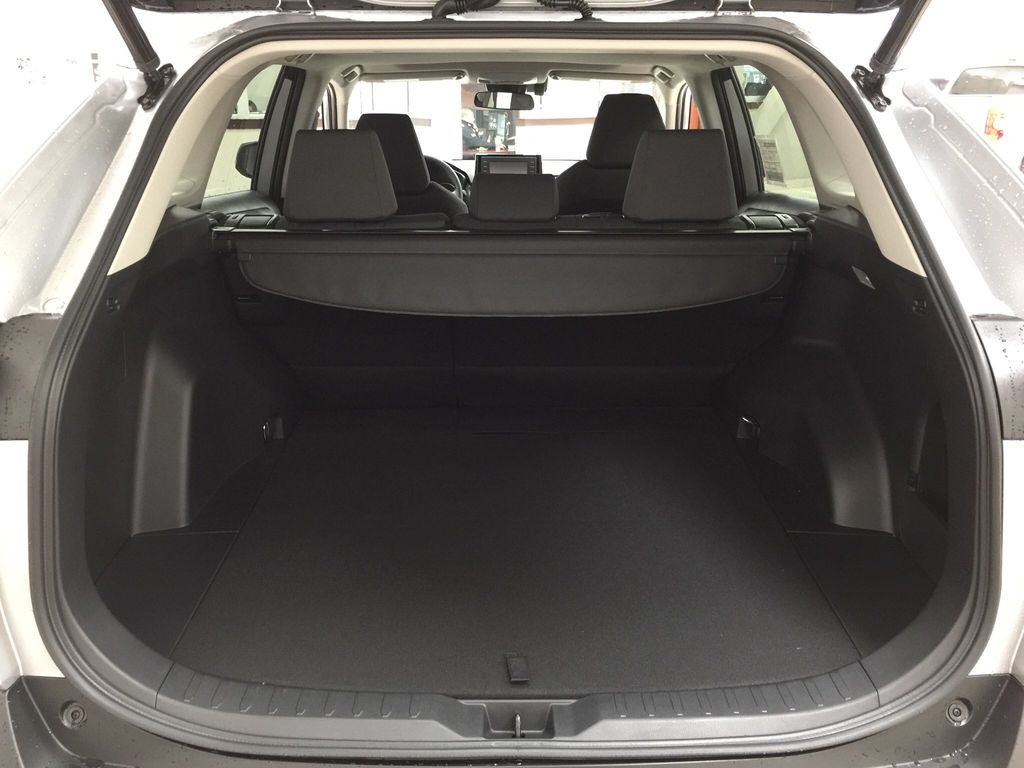 Silver[Silver Sky Metallic] 2021 Toyota RAV4 XLE FWD Cargo Area/Rear Seats Photo in Sherwood Park AB