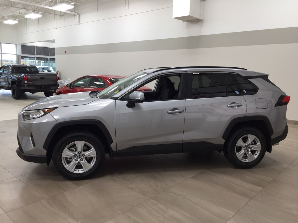 Silver[Silver Sky Metallic] 2021 Toyota RAV4 XLE FWD Left Side Photo in Sherwood Park AB