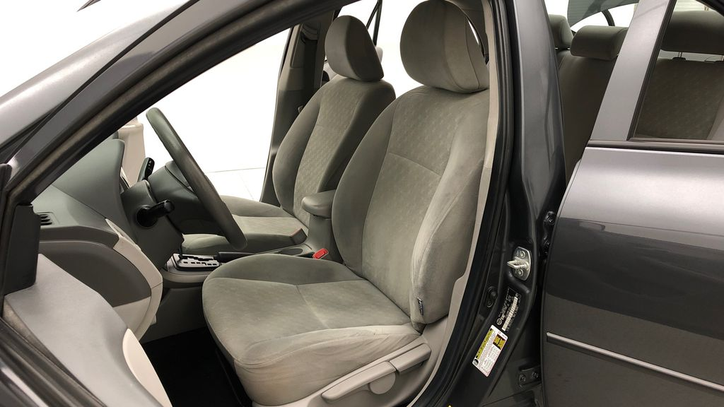 Gray[Magnetic Grey Metallic] 2010 Toyota Corolla CE - Automatic, A/C, Crusie Control Left Front Interior Photo in Winnipeg MB