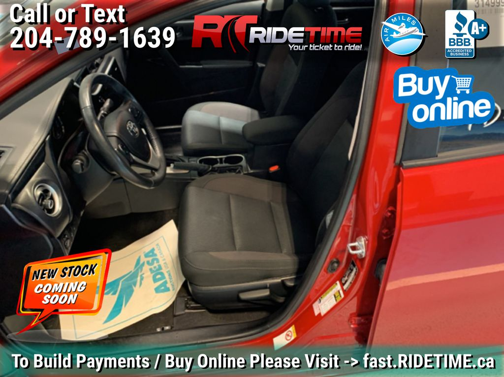 Red[Barcelona Red Metallic] 2017 Toyota Corolla LE - Bluetooth, Heated Seats, Sunroof, Alloy Wheels Left Front Interior Photo in Winnipeg MB