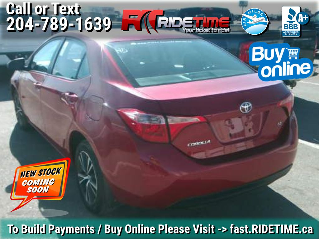 Red[Barcelona Red Metallic] 2017 Toyota Corolla LE - Bluetooth, Heated Seats, Sunroof, Alloy Wheels Left Rear Corner Photo in Winnipeg MB