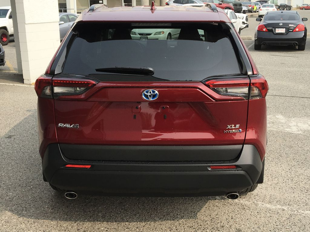 Red[Ruby Flare Pearl] 2021 Toyota RAV4 Hybrid  XLE Rear of Vehicle Photo in Kelowna BC