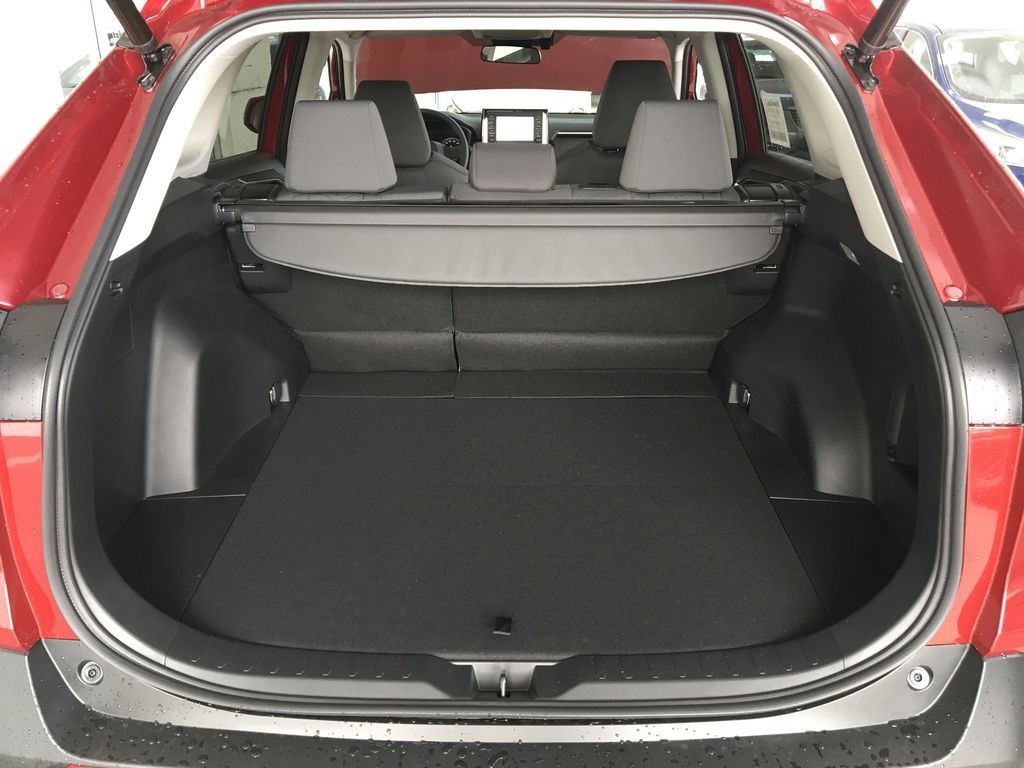 Red[Ruby Flare Pearl] 2021 Toyota RAV4 Hybrid  XLE Trunk / Cargo Area Photo in Kelowna BC