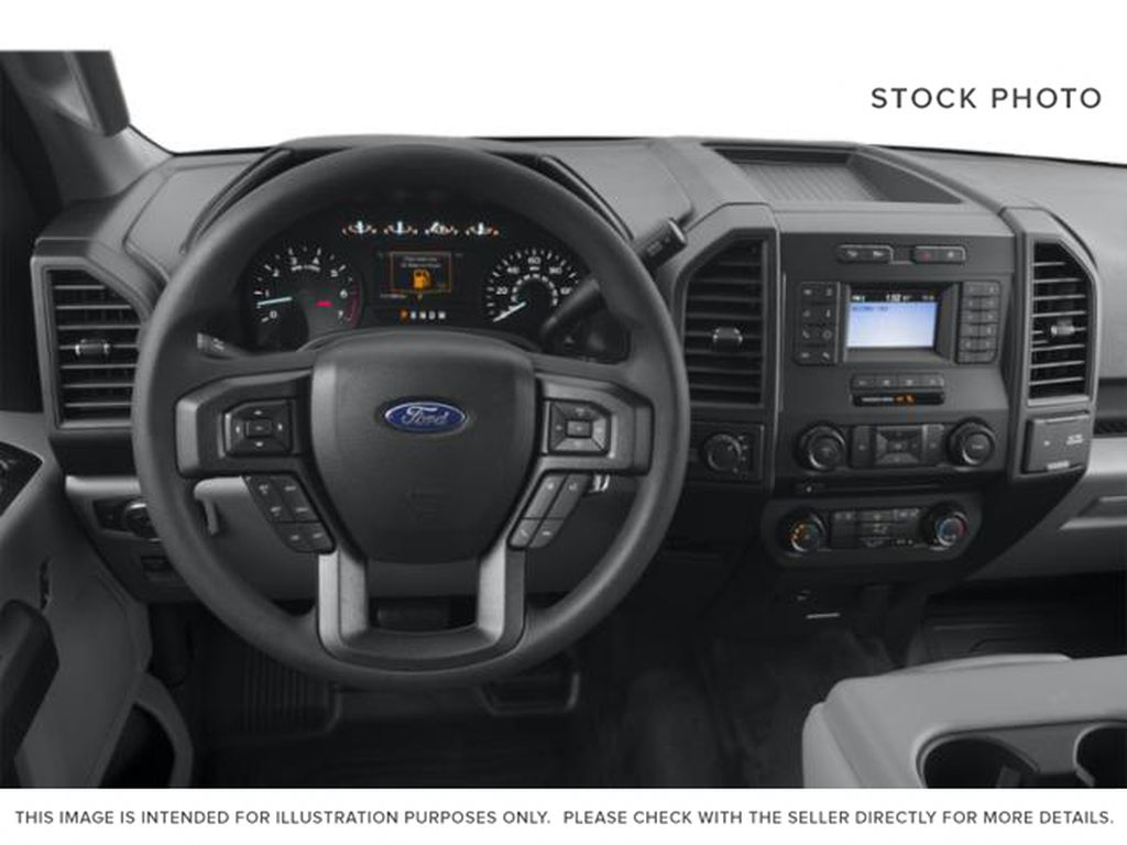 Blue 2018 Ford F-150 Steering Wheel and Dash Photo in Medicine Hat AB