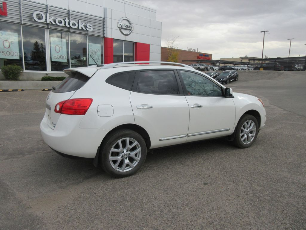 White[Hakone White Pearl] 2012 Nissan Rogue Driver's Side Door Controls Photo in Okotoks AB