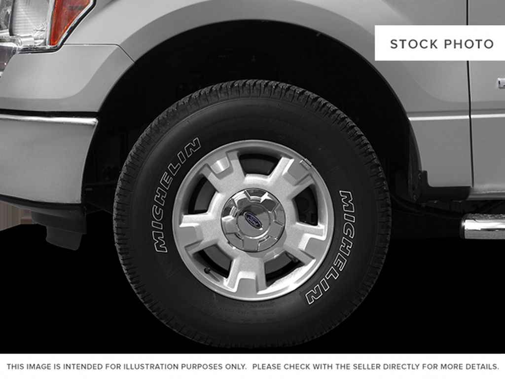 Blue[Blue Flame] 2014 Ford F-150 Left Front Rim and Tire Photo in Fort Macleod AB