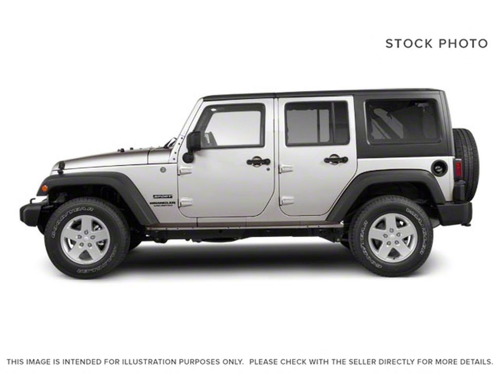 Silver[Bright Silver Metallic] 2011 Jeep Wrangler Unlimited Left Side Photo in Fort Macleod AB