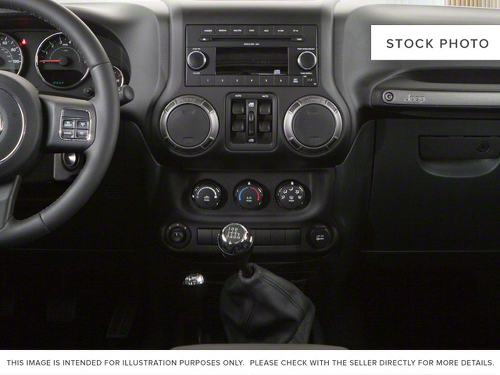 Silver[Bright Silver Metallic] 2011 Jeep Wrangler Unlimited Center Console Photo in Fort Macleod AB