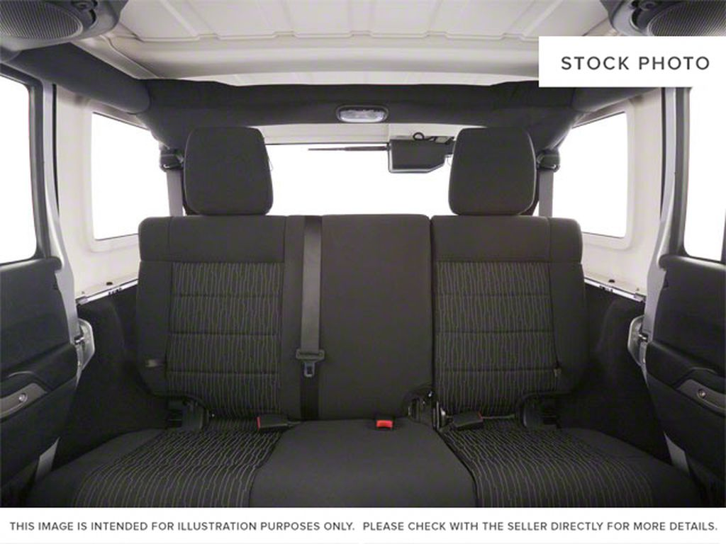 Silver[Bright Silver Metallic] 2011 Jeep Wrangler Unlimited Left Side Rear Seat  Photo in Fort Macleod AB