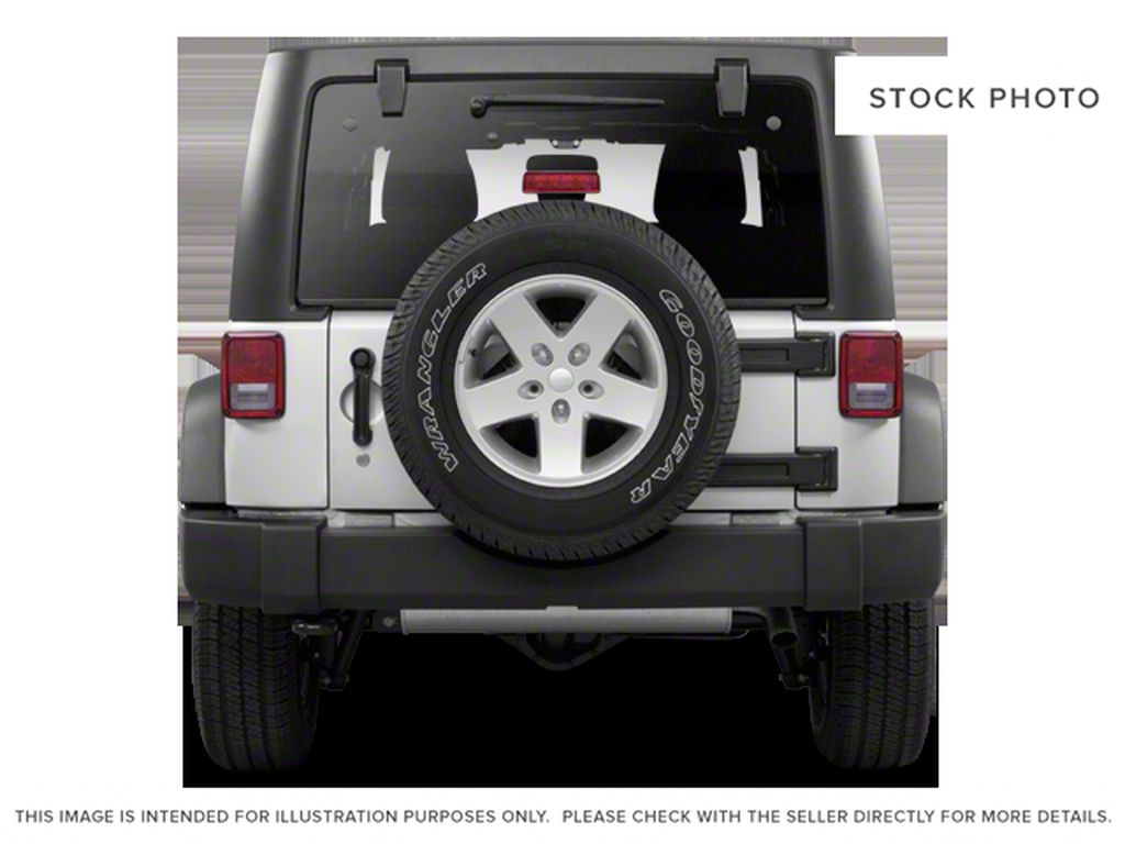 Silver[Bright Silver Metallic] 2011 Jeep Wrangler Unlimited Rear of Vehicle Photo in Fort Macleod AB