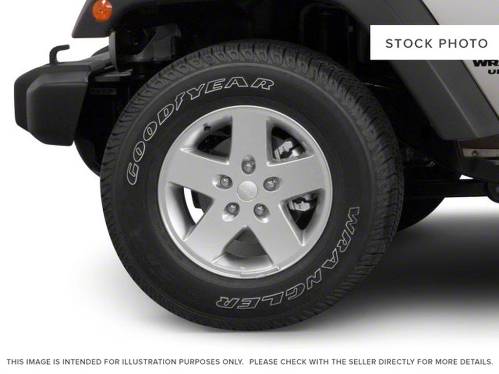 Silver[Bright Silver Metallic] 2011 Jeep Wrangler Unlimited Left Front Rim and Tire Photo in Fort Macleod AB