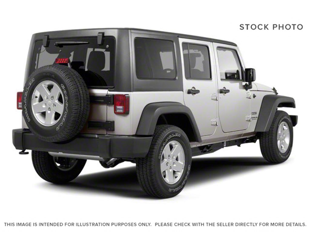Silver[Bright Silver Metallic] 2011 Jeep Wrangler Unlimited Right Rear Corner Photo in Fort Macleod AB