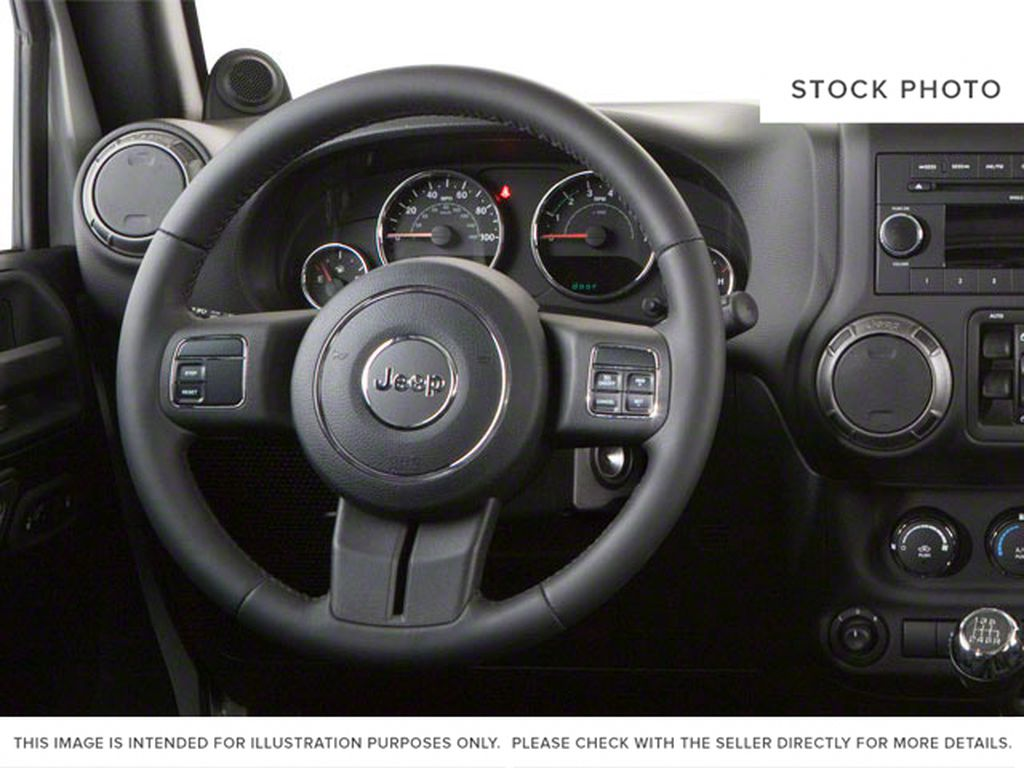 Silver[Bright Silver Metallic] 2011 Jeep Wrangler Unlimited Steering Wheel and Dash Photo in Fort Macleod AB
