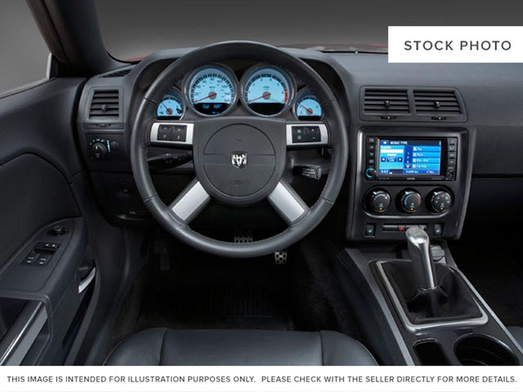 Black[Brilliant Black Pearl] 2009 Dodge Challenger Steering Wheel and Dash Photo in Fort Macleod AB