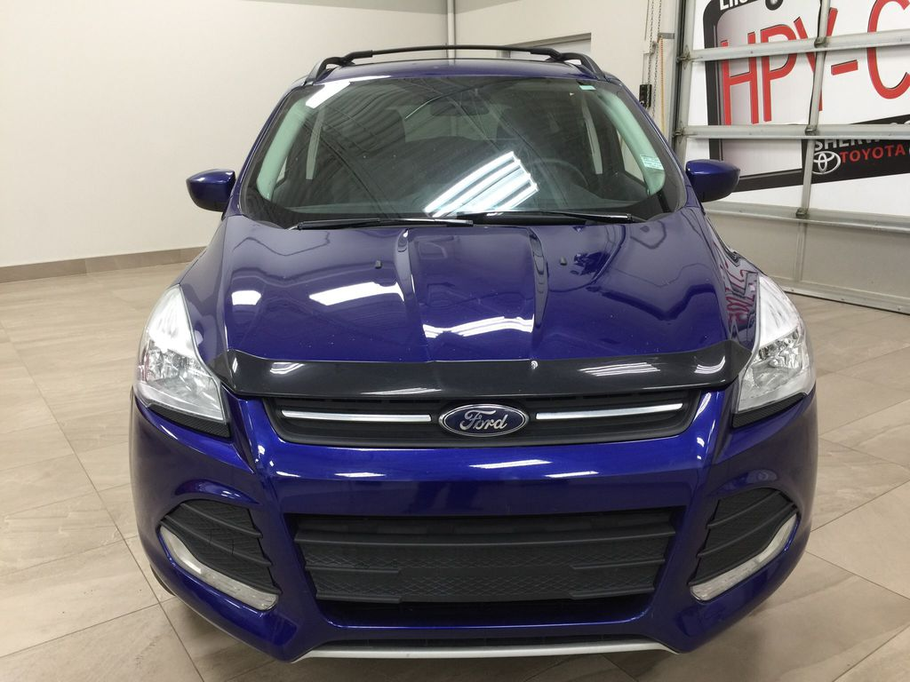 Blue[Deep Impact Blue Metallic] 2016 Ford Escape SE Front Vehicle Photo in Sherwood Park AB
