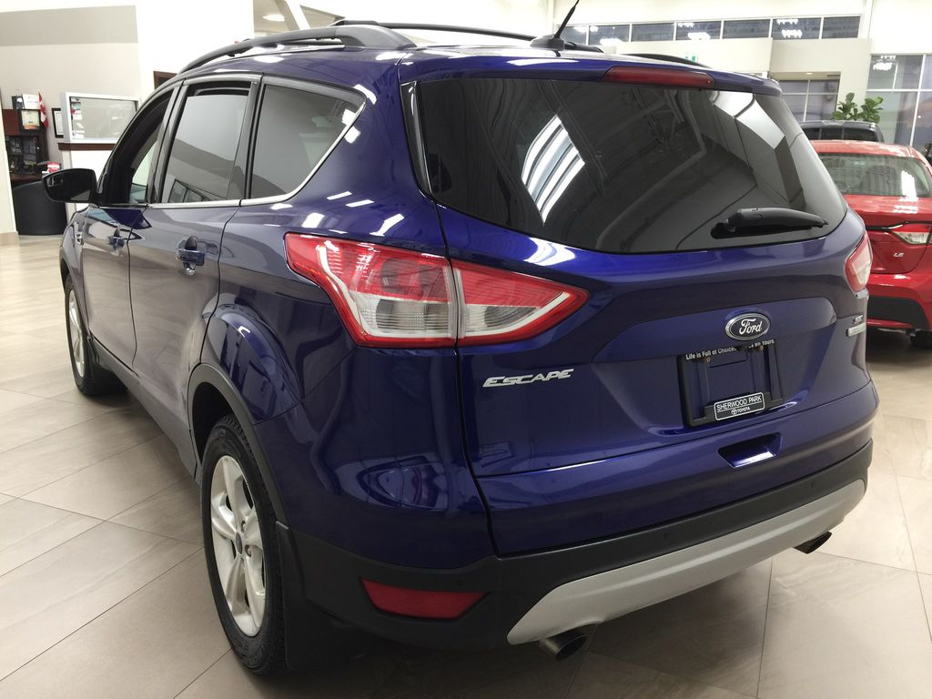 Blue[Deep Impact Blue Metallic] 2016 Ford Escape SE Left Rear Corner Photo in Sherwood Park AB