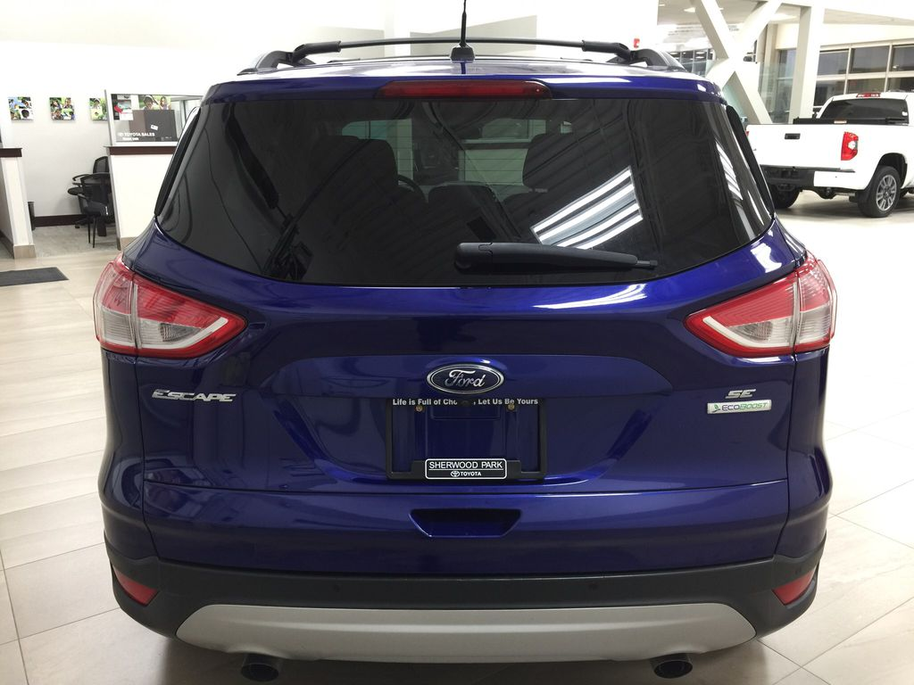 Blue[Deep Impact Blue Metallic] 2016 Ford Escape SE Rear of Vehicle Photo in Sherwood Park AB