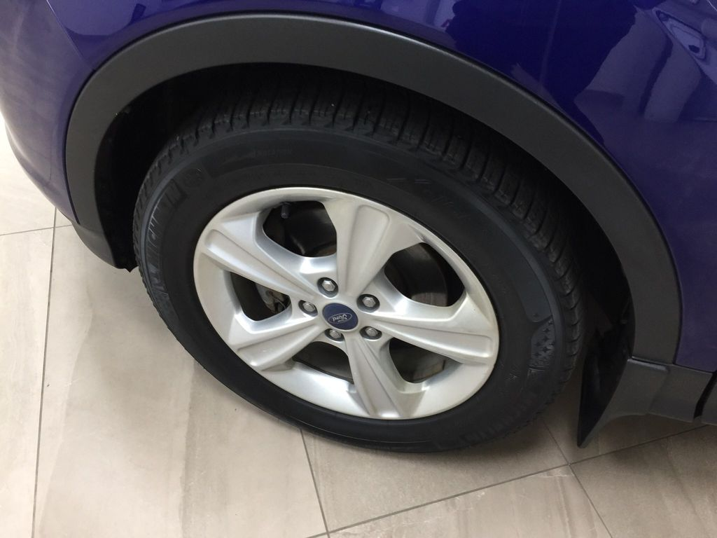 Blue[Deep Impact Blue Metallic] 2016 Ford Escape SE Left Front Rim and Tire Photo in Sherwood Park AB