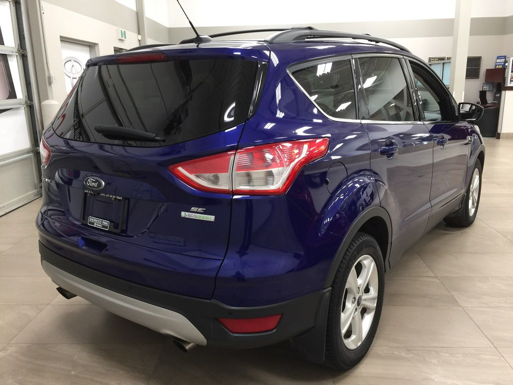 Blue[Deep Impact Blue Metallic] 2016 Ford Escape SE Right Rear Corner Photo in Sherwood Park AB