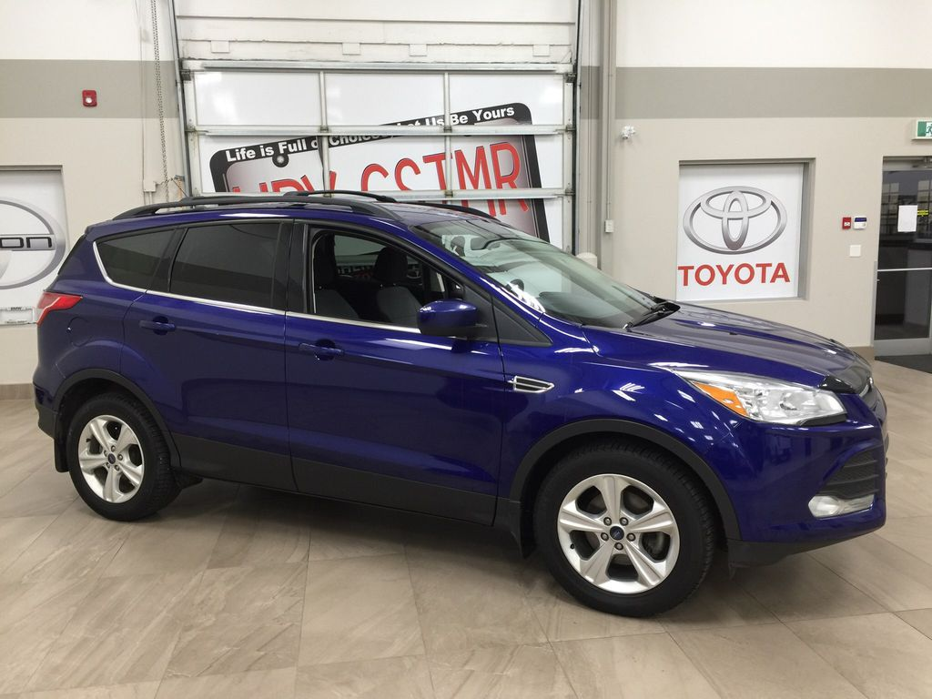 Blue[Deep Impact Blue Metallic] 2016 Ford Escape SE Right Side Photo in Sherwood Park AB