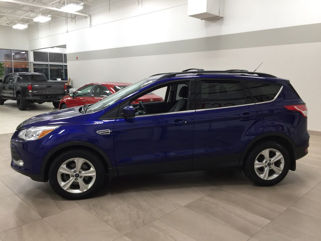 Blue[Deep Impact Blue Metallic] 2016 Ford Escape SE Left Side Photo in Sherwood Park AB