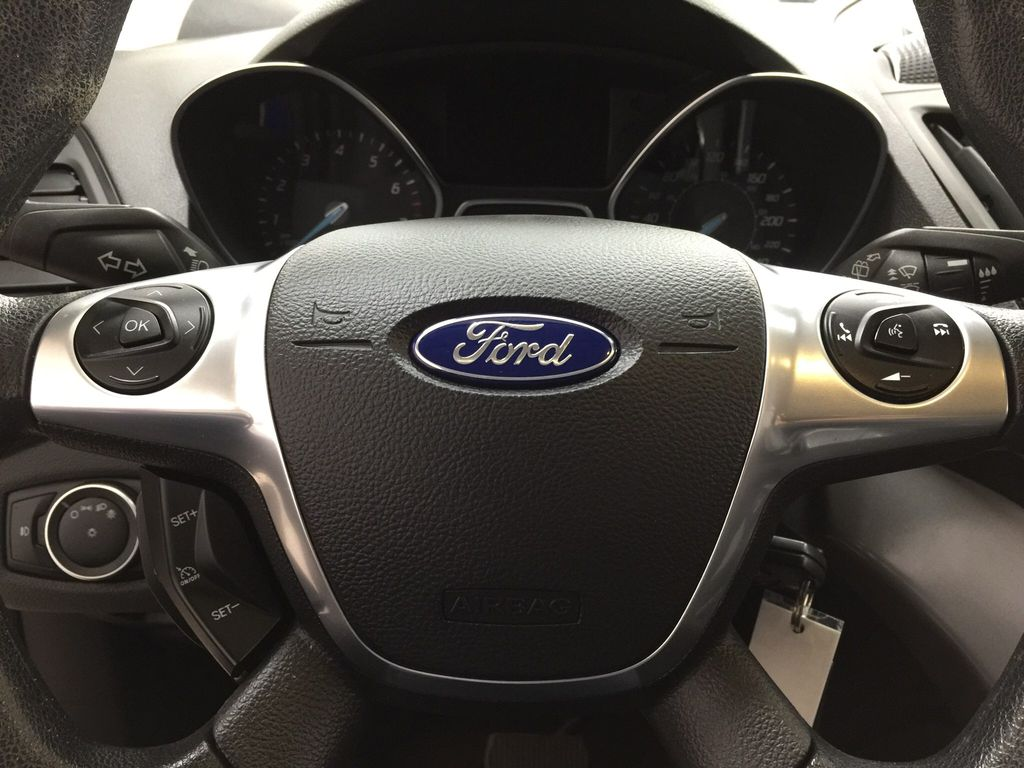 Blue[Deep Impact Blue Metallic] 2016 Ford Escape SE Steering Wheel and Dash Photo in Sherwood Park AB