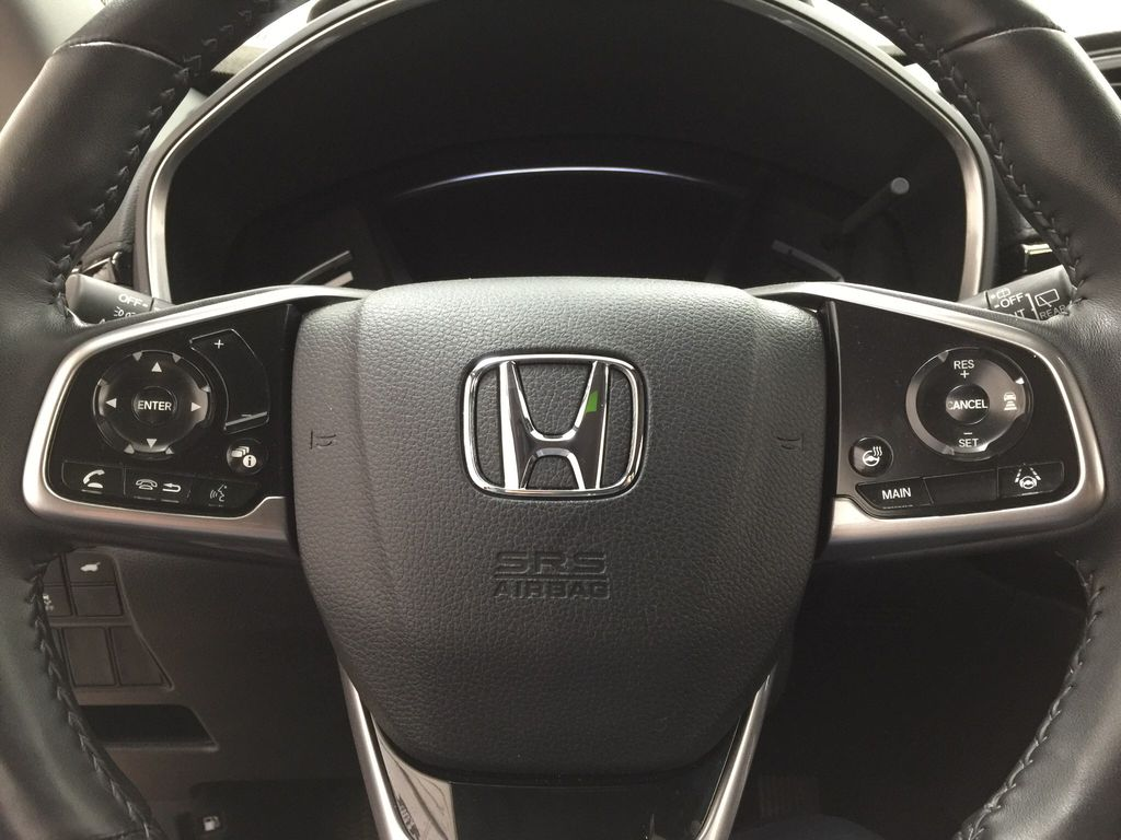 Red[Molten Lava Pearl] 2019 Honda CR-V Touring AWD Steering Wheel and Dash Photo in Sherwood Park AB