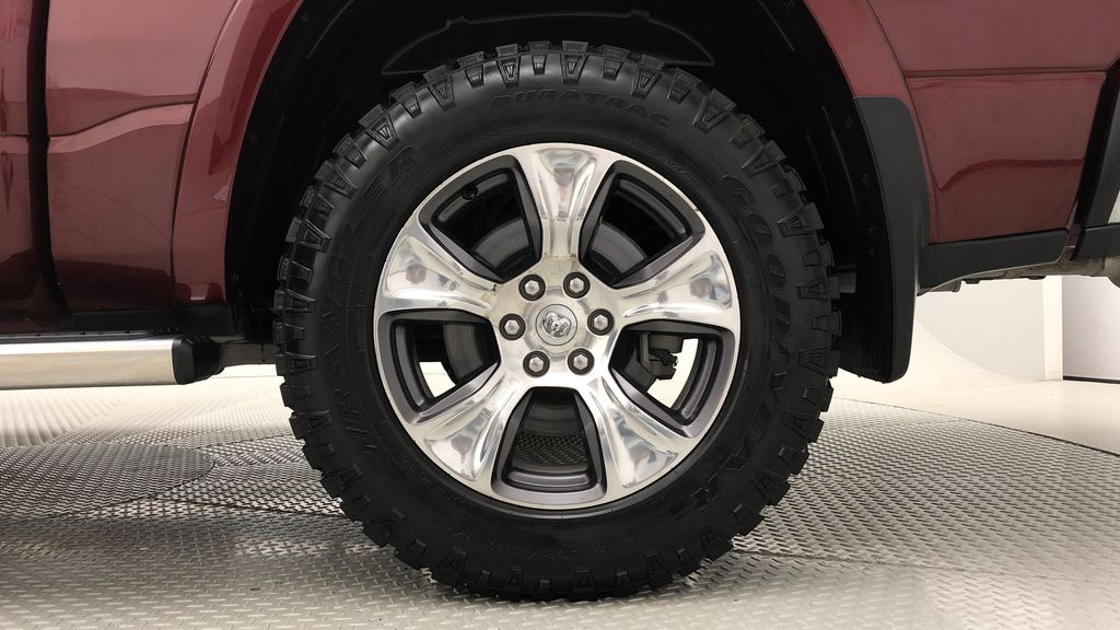 Red[Red Pearl] Lifted 2019 Ram 1500 Laramie 4WD - Pano Roof, 12in Display, Crew Cab Left Rear Rim and Tire Photo in Winnipeg MB